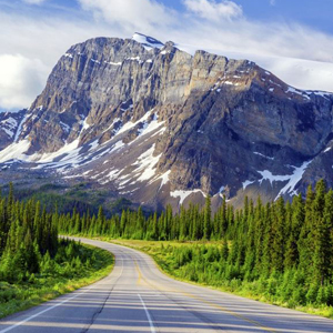 A rocky mountain with some glacier ice on the Ice fields parkway in Canada.